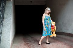 Woman and teddy-bear Stock Photos