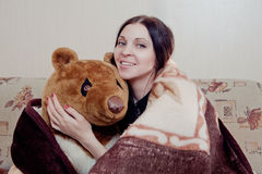 Woman with teddy bear Stock Photo
