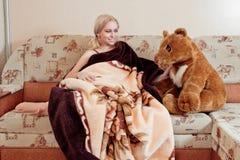 Woman with teddy bear Royalty Free Stock Photos