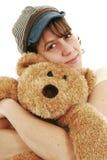 Woman and teddy bear. Woman giving a big hug to a teddy bear royalty free stock image