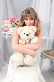 Woman and teddy bear Royalty Free Stock Image