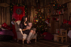 Woman with teddy bear near christmas decorations Royalty Free Stock Photography