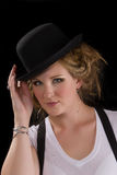 Woman in tee shirt and black hat royalty free stock image