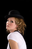 Woman in tee shirt and black hat stock image