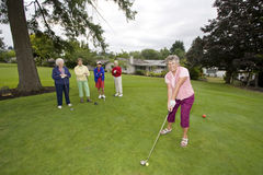 Woman Teeing Off Royalty Free Stock Photo
