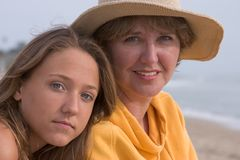 Woman and teen. Mother and daughter together on the beach stock photos