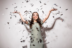 Woman or teen girl in fancy dress with sequins and confetti at party Royalty Free Stock Photos