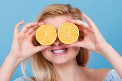 Girl covering her eyes with lemon citrus fruit Stock Images