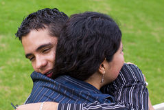 Woman teen hug. Woman and young teen man hug stock image