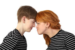 Woman and teenage boy resting heads against each other Stock Photography