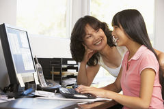 Woman And Teenage Daughter Using Computer Stock Images
