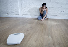 Woman or teenager girl sitting on ground alone worried at home Royalty Free Stock Photography
