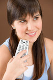 Woman teenager hold remote control Stock Photos