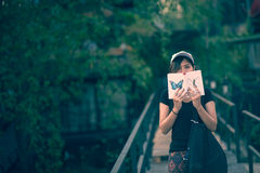 Woman teenager sitting enjoy reading book . Stock Image
