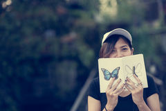 Woman teenager sitting enjoy reading book . Royalty Free Stock Photography