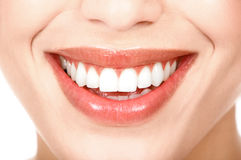 Woman teeth. Beautiful young woman teeth. Isolated over  white background Royalty Free Stock Image