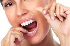 Woman teeth with dental floss. Stock Image