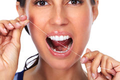 Woman teeth with dental floss. Stock Photo