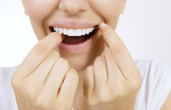 Woman and teeth floss Stock Photography