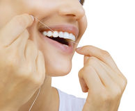 Woman and teeth floss Stock Image