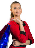 Woman with teeth smile handing bags Royalty Free Stock Photos