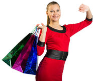 Woman with teeth smile handing three bags Stock Image