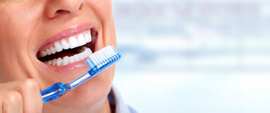 Woman teeth with toothbrush. Stock Photo