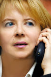 Woman at telephone Stock Image