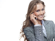 Woman with telephone. Attractive young woman with telephone on white background Royalty Free Stock Photography