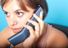 Woman with telephone. Young woman at office with telephone Stock Photo