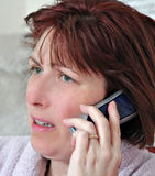 Woman on telephone. Photo of a model using a modern digital cordless telephone Royalty Free Stock Photo