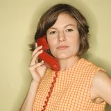 Woman with telephone. Royalty Free Stock Images