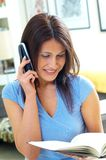 Woman and telephone Royalty Free Stock Images
