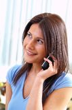 Woman and telephone. Young woman with telephone and book Royalty Free Stock Images
