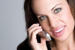Woman on Telephone. Beautiful smiling woman on telephone Stock Photo
