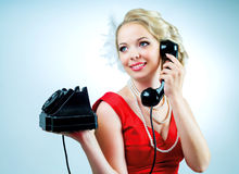 Woman with a telephone Stock Image