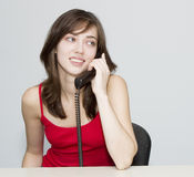 The woman. Telephone conversation. Telephone conversation. The woman in red Royalty Free Stock Photography