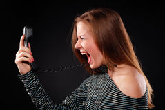 Woman with telephone receiver Stock Image