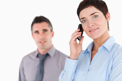 Woman telephoning while her colleague is posing Stock Photo