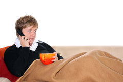 Woman telephoning on a Sofa. Holding a Teacup Stock Photography