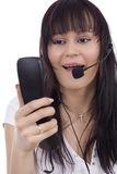 Woman telephonist. With hands-free phone Royalty Free Stock Images