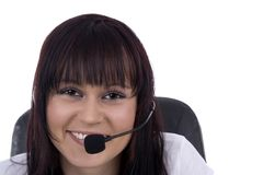 Woman telephonist. With hands-free phone against a white background Royalty Free Stock Images