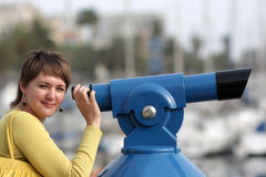 Woman with telescope Royalty Free Stock Image