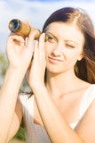 Woman With Telescope Royalty Free Stock Images