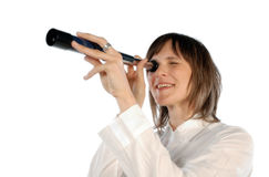 Woman with telescope. Smiling woman looking through a telescope royalty free stock photos