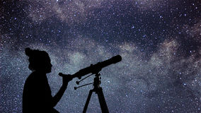 Woman with telescope watching the stars. Stargazing woman and ni royalty free stock photography