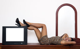 Woman with a television. Attractive woman with a television Royalty Free Stock Photo