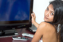 Woman with television Stock Photos