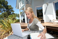 Woman teleworking from home terrace Stock Photo