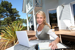 Woman teleworking in laptop Stock Photo